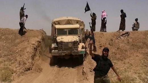 Gewapende strijders van ISIS bij de grens tussen Syrië en Irak Foto |  © AFP .