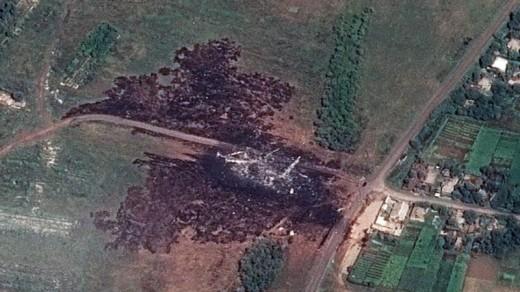 De rampplek na de crash van de MH17. Het is waarschijnlijk geen ongeluk geweest.  FOTO: EPA .