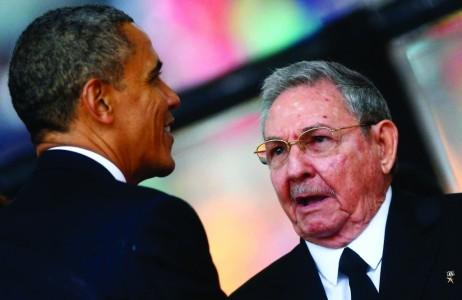 U.S. President Barack Obama (L) greets Cuban President Raul Castro