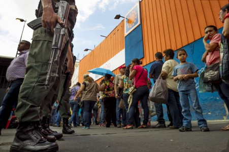 Shoppers queue outside the supermarket 'Dia a Dia' in Caracas, Venezuela, on Tuesday. The government took over stores of supermarket chain after alleging that it was hoarding food. According to many economists, government controls are making the economic crisis worse   Foto  Miguel Gutierrez/EPA/Landov